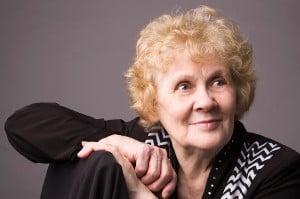 The elderly woman.