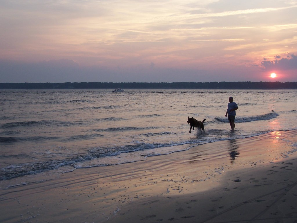 My husband and our late dog, Hunter, at sunset.