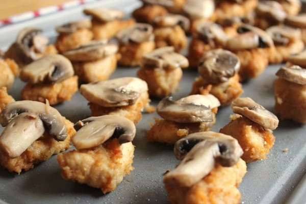 Place mushrooms on top of Chik Fil A nuggets