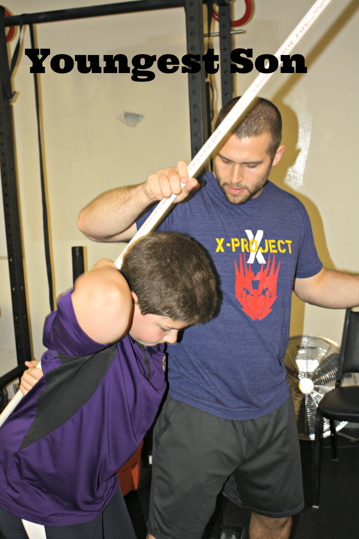 Michael working with Sean on proper form.