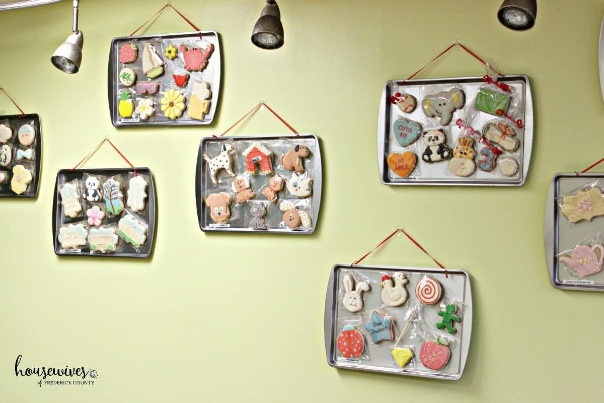 Samples of different cookie decorating themes are on the walls