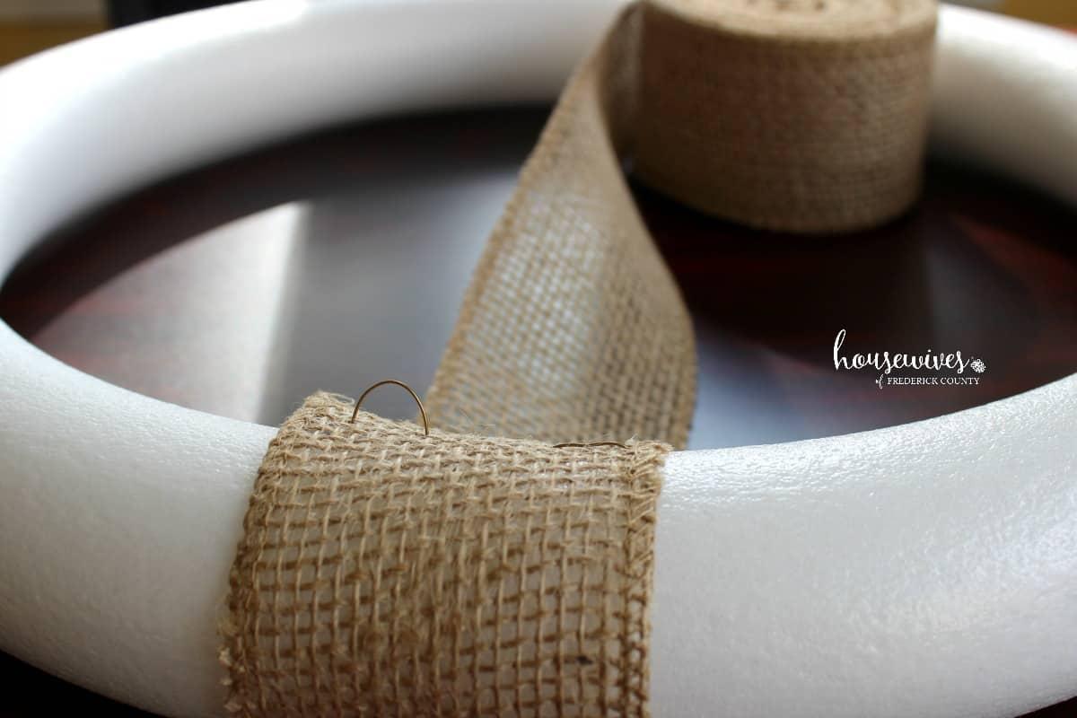 Attaching burlap ribbon to foam wreath form