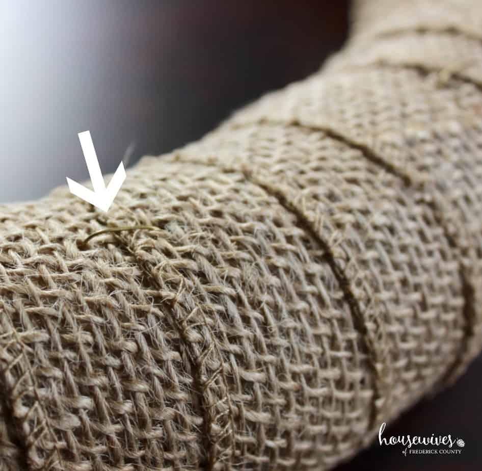 U pins keep burlap ribbon in place on foam form
