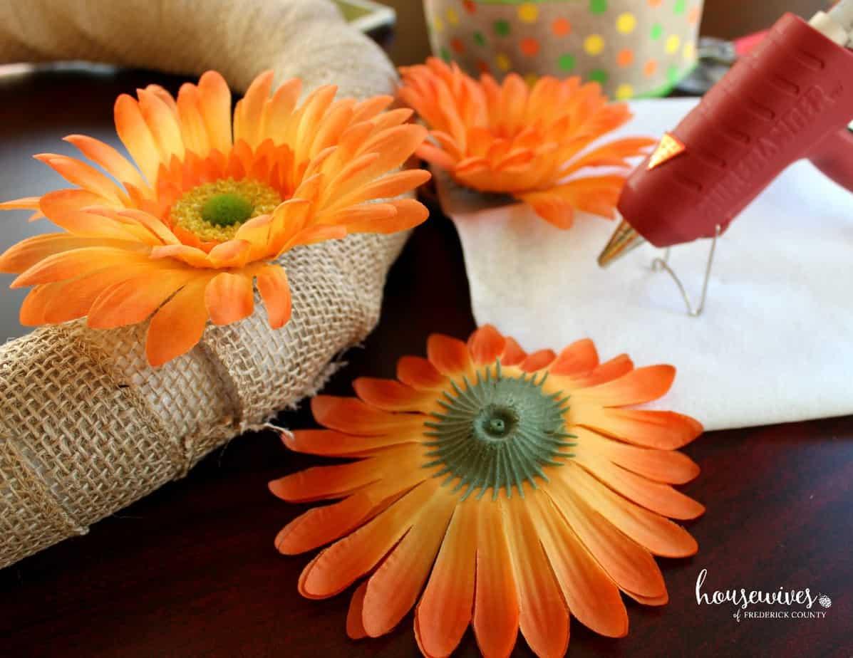 Hot glue flowers to burlap for your front door wreath