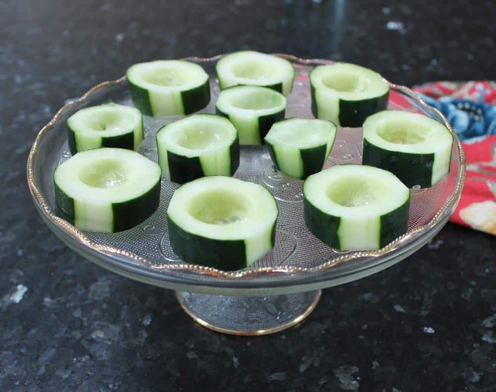Arrange cucumber cups onto a serving tray
