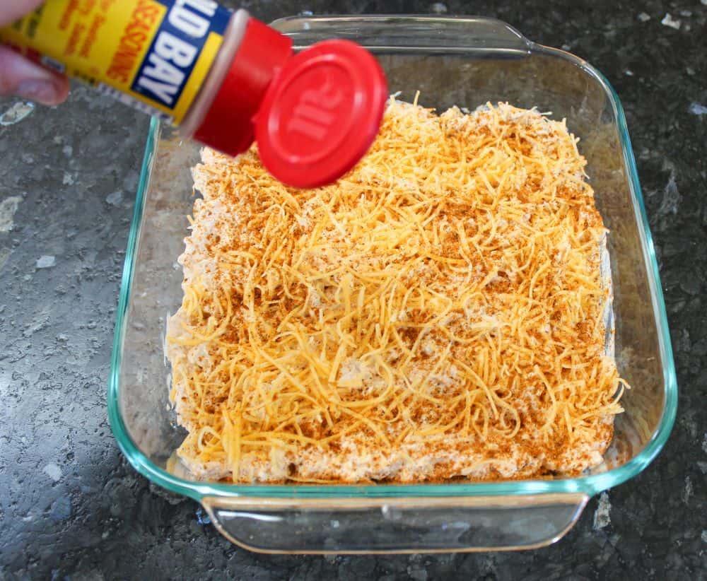 Spread shredded cheddar cheese and Old Bay Seasoning